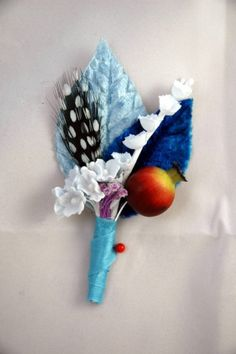 This is for a beautiful wedding boutonnaire/ corsage made in the colour blues, whites, red and purple.