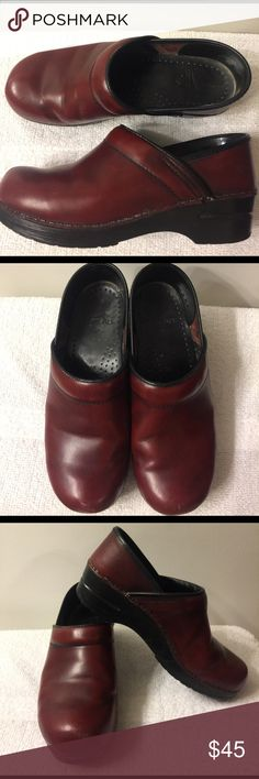 Dansko Red/Wine Clogs Size 38 $45 Dansko Red/Wine Clogs Size 38 Great Condition- no undone stitching. perfect shoes for nurses, waitresses or any job that requires a lot of walking or standing $45 Dansko Shoes Mules & Clogs
