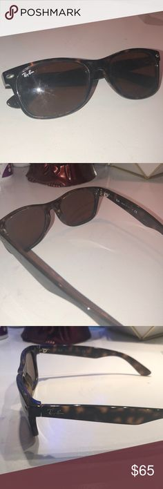 Ray - Bans Sunglasses Tortoise shell pattern. Lightly used but in good condition. Ray-Ban Accessories Sunglasses