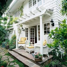 Inviting An attached pergola can add warmth to an otherwise sparse exterior. Without this shallow pergola, the French doors and back expanse of this house would seem stark. With it, the space gains architectural detail and becomes an inviting nook. Outdoor Rooms, Outdoor Gardens, Outdoor Living, Small Front Porches, Small Patio, Small Pergola, White Pergola, Small Yards, Pergola Patio