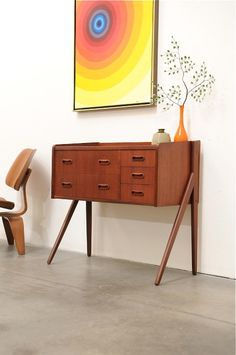 great angled legs and pulls on this vintage mid century Danish piece.