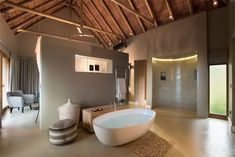 Hotel interior for the Mhondoro Game Lodge by All-In Living. Bar Piscina, Cabana, Lodge Bathroom, Modern Tropical House, African House, Chalet Design, Game Lodge, Thatched House, Hotel Room Design