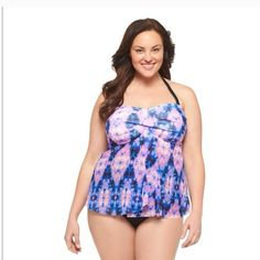 LAST ONE--New plus size swim top in size 22W Purple Tie Dye. This tankini top is in a bandeau style strapless.  In a gorgeous tie-dye print, this swimsuit top, which combines brilliant purple, blue and black, has a built-in shelf bra for support and a layered, pleated front to flatter your tummy Built in shelf bra 92% Nylon UPF 50 I have 1 NWOT and is missing straps. Ava & Viv Swim One Pieces