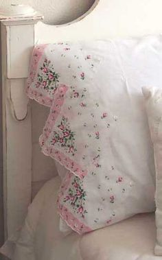 Pillowcase edges with dainty vintage hankies.