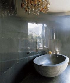 Concrete-Bathtub belonging to Jean-Pascal Lévy-Trumet via Elle Decor I Remodelista