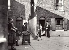 A postman delivering mail in Wapping, 1935