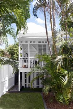 Beach society: A Queenslander workers cottage becomes an entertainer's paradise | Inside Out Cottage Renovation, Front Fence, Queenslander, Deco, Curb Appeal, House Tours, Facade, Beautiful Homes, Paradise