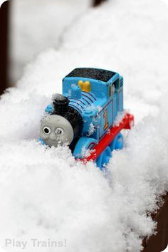 Winter Train Play in the Snow, this is a great form of sensory play, and a fun way to explore science in a playful, hands-on way. {Play-Trains} #Trains #Snow