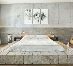 Reclaimed timber bed against a natural stone wall