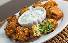 Kolokythokeftedes (Zucchini and Feta Balls) - Zucchini, feta and plenty of fresh herbs rolled into balls and fried until light and crispy and golden brown. For Low Carb use favorite flour, breadcrumbs substitute - Serve with tzatziki or marinara sauce
