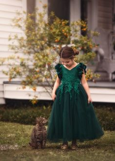 Fit for a princess, this dress has it all. Regal emerald satin graced with a touch of lace, this dress is a showstopper! Sleeves are embellished with whimsical die cut flowers that will have all eyes on her. Full Length Gowns, Full Length Skirts, Daddy Daughter Dance Dresses, Popular Dresses, Holiday Dresses, Flower Girl Dresses, Flower Girls, Girl Outfits, Wedding Dresses