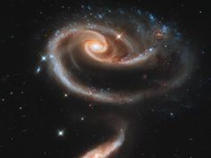 To celebrate the 21st anniversary of the Hubble Space Telescope, astronomers pointed Hubble's eye at an especially photogenic pair of interacting galaxies called Arp 273.