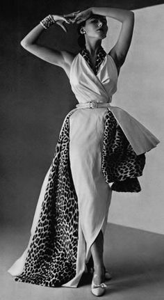 """Model wearing couture fashion with leopard skin, 1950s. had a dress like this, but no animal print. it was all one color..and I could remove the over skirt for a different look.  Made by """"Millie"""" of course."""