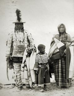 Assiniboine Indians: Long Knife with his wife and grandchild. Fort Belknap, Montana, 1899