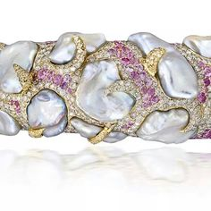Lot 92. An attractive cultured pearl, coloured sapphire and diamond bangle, by Andre Marcha. Estimate 20,000 - 30,000 U.S. dollars