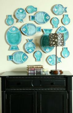 Turquoise fish on the wall.