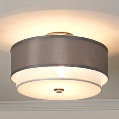 Silver Sheer Double Shade Ceiling Light A pewter silky drum shade layered over a silver organza drum shade takes modern elegance to the next level!