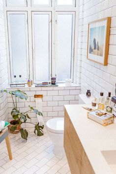 A clean, bright bathroom lined with subway tiles