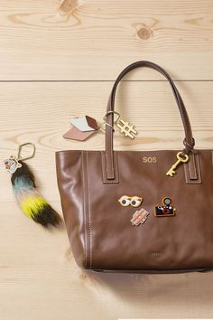 Stickers, bag charms, embossed monograms and more. We can't get enough of this personalized leather Emma tote.