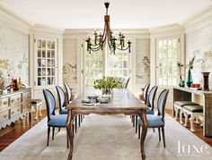 Custom walnut-and-leather chairs surround the dining area's walnut Joseph Jeup table, which is illuminated by cast-glass Alison Berger Glassworks chandeliers. A Chris Gwaltney work hangs above the Ironies console from Kneedler Fauchère with bone-inlaid doors and a bronze base.