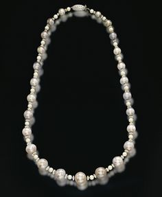 AN IMPORTANT NATURAL COLOURED PEARL, PEARL AND DIAMOND NECKLACE, BY VAN CLEEF & ARPELS