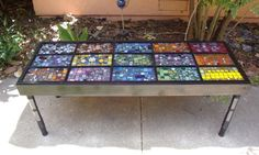 DIY mosaic table - Would love this as a garden bench.