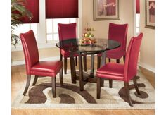 A dining set for the trendy, the Charrell collection features bold flair in a dynamic design. The glass circular table with its beveled edges and sturdy criss-crossed leg frames is complimented nicely with 4 red faux leather, swooped back chairs giving this set a unique look. For a dining room with character, Charrell is the perfect choice!