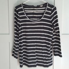 J.Crew gray and white striped tee Three quarter sleeves, zipper in the back, only worn a few times. Although it's a large, I'm normally a small/medium in tees and this fits like a medium. J. Crew Tops