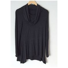 Gray sharkbite sides tunic top Perfect charcoal gray cowl neck style soft tunic with slight sharkbite style sides. 97% viscose/3% spandex. Size M, 30in. long at longest parts, chest 15in. across, sleeves, sleeves 24in. long. Tops Tunics