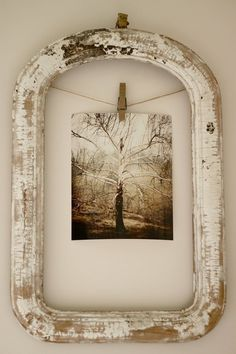 rustic frame, clothespin, twine. love love love. and so simple