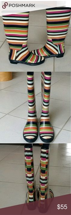Coach Rain Boots Pink, blue , green multi colored striped rain boots. Very minimal use. I just use my black and brown ones more. True to sz. Perfect for rain or snow Coach Shoes Winter & Rain Boots
