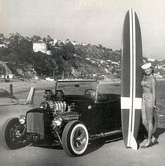 Early 50s - Long ass long board bitchin' 32 roadster sailor hat gal in a bikini and low heels by the beach!