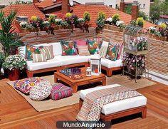 terraza con muebles fabricados a base de palets