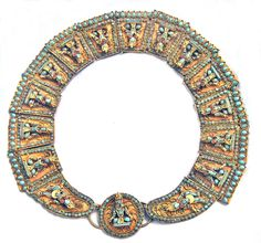 Old Tibetan Buddha panel collar. Including the round front piece there are a total of 15 linked panels all with sculptural figures - the only two that don't have sitting Buddhas are the panels bordering the center piece - they have dancing figures. The turquoise is inlaid glass/faience - look very carefully - faces are molded faience with subtle features. The coral are either glass or actual coral. The base is brass - back has a gold-wash finish.