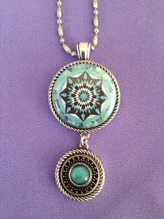 "Double Dutch Pendant with Native Sun 1"" and Turquoise Burst 9/16"" bittie insert"