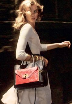 a7ba630f8f Karlie Kloss models the DVF Secret Agent bag.