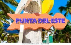 Punta Del Este signpost with a trees.