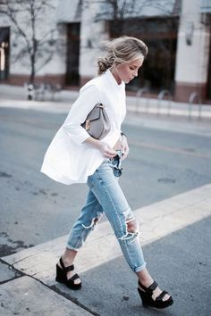 classic white blouse with distressed denim and black platforms