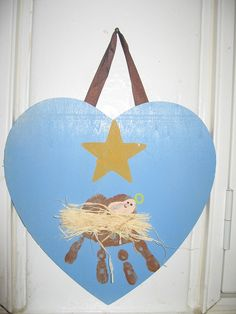 """Handprint nativity. Poem on the back: """" I used my hand to make a manger, a place for Jesus to lay. I'll use my heart so full of love, as a place for Jesus to stay."""""""