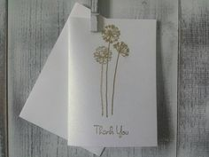 You cant go wrong with these simple and cute thank you cards! They can be used for all occasions and make great wedding thank you cards. You can also purchase them for the bride to be to use for her big day.  Each card is handmade. I stamp the flowers and thank you onto the card and then finish it with a heat embossed powder.  Each card has a handmade with love stamp on the back.  Cards measure 3.5 x 5 and come with coordinating white envelopes packaged with ribbon.  I have the cards sold in…