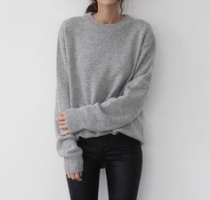 grey sweater coated black jeans