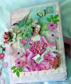 5x7 Journal, with 80 lined pages. the front and back covers are embellished in Marie style. The inside front and back covers are also embellished. The