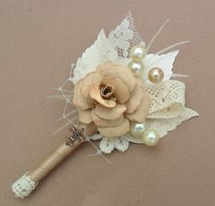 Vintage chic boutonniere with pearl accents. @Gwen Foreman and @Katie Stanford ?!?!
