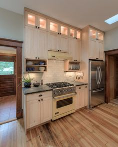 put reeded-glass fronts on the topmost cabinets and lit them. .. They are smart. Not only does it keep it dust free which is why they did it. . But it adds extra light to the kitchen.