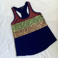 ⚡️Flash Sale⚡️Express Sequin Top EUC This sequin top is so unique with red, green, and yellow sequins. Dress up a pair of jeans and stand out! Express Tops Tank Tops
