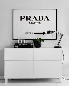 Cleanly designed with a black and white posters. Stylish Prada print!
