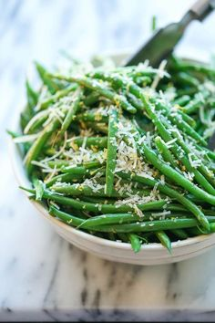 Lemon Parmesan Green Beans - Super simple skillet green beans. Perfectly crisp-tender, smothered in lemon zest and Parmesan cheese. Easy and flavorful!