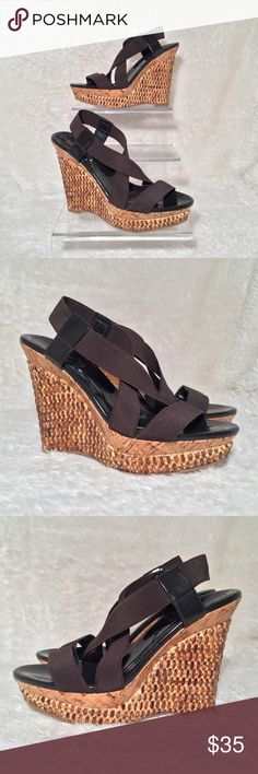 BCBGirls Mely Platform Wedge Chocolate Brown In excellent used condition. Worn once. Features an elastic brown upper with an open-toe, brown patent side straps and midsole, and a unique double platform with cork and basket weaving on the 1¾ inch platform and a 5 inch wedge heel. Women's size 8.  Comes from a pet free and smoke free home. BCBGirls Shoes Wedges