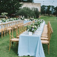 Another peek at the romantic outdoor wedding we styled for one of our beautiful couples recently. We LOVE long feasting tables, and these beauties were draped in soft blue linen, set off by oak timber chairs and lit by strings of festoons #receptionperfection 📷 @karinajadephotography chairs & festoons @dress_my_wedding florals @flowersinavase1 venue @mansionhotelspa linen @linenhiredisimmonsevents #outdoorwedding #feastingtables #weddingbanquet #melbournewedding #tablescape
