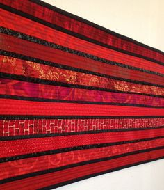 """Red quilted table runner. Table topper. Home accent. Minimalist. Modern home decor. 12x40"""". For the table. Modern quilt. Bureau scarf. by AnnBrauer on Etsy"""
